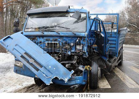 Damaged big truck after car