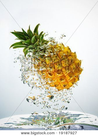 Pineapple splashing in water