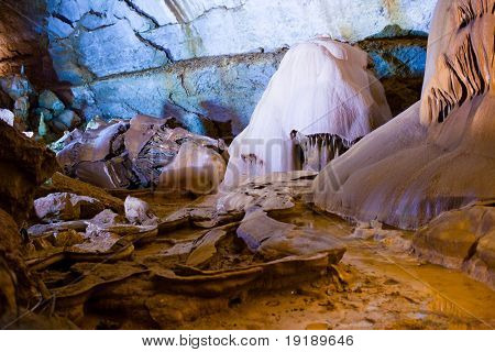 Underground cave interior with color lighting