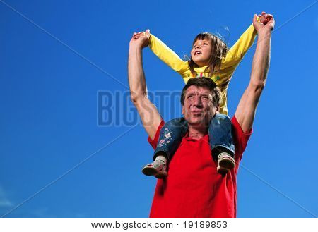 grandfather with granddaughter under blue sky