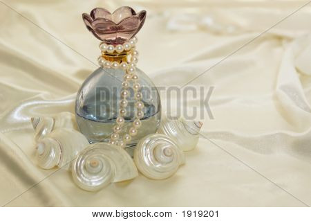 Perfume Bottle And Pearls
