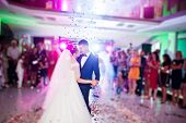 Touching And Emotional First Dance Of The Couple On Their Wedding With Confetti And Colorful Lights poster