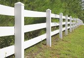 stock photo of split rail fence  - A long decorative white split rail fence - JPG