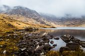 A Beautiful Irish Mountain Landscape With A Lake In Spring. Gleninchaquin Park In Ireland. poster