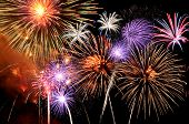 picture of firework display  - Fireworks of various colors bursting against a black background - JPG