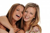 picture of beautiful women  - Two Young beautiful Sisters smiling isolated on a white background - JPG