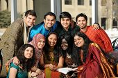 pic of traditional attire  - Group of Diverse College Students wearing their traditional attire in the University Campus - JPG