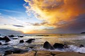 stock photo of beach sunset  - Tropical sunset on the stones beach - JPG