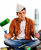 Repair home man holding paint bank. Tired mad male in newspaper cap renovation apartment. Paint bank poster