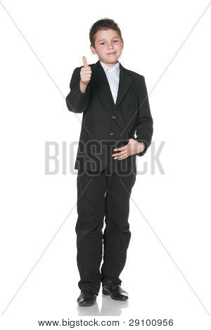Happy Kid In Suit Holding Thumb Up