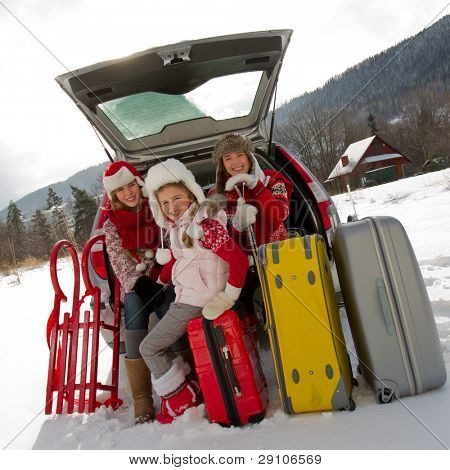 Winter, travel - family with baggage ready for the travel for winter vacation