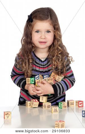 Adorable baby playing with wooden blocks isolated over white background