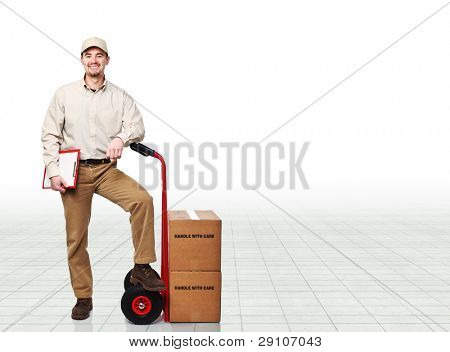 manual worker with handtruck and boxes