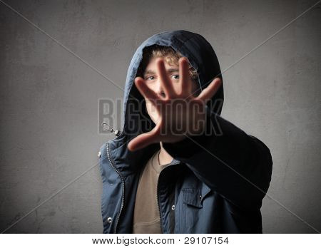 Young man hiding behind his hand