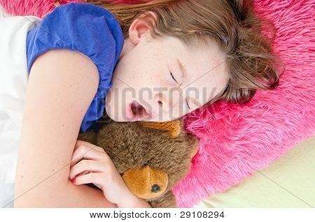 Girl sleeping with lovey bear