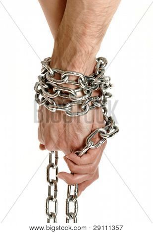 Closeup of couple hands tied together with a chain conceptual photo isolated on white background