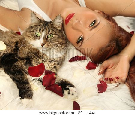cute woman with cat on fur