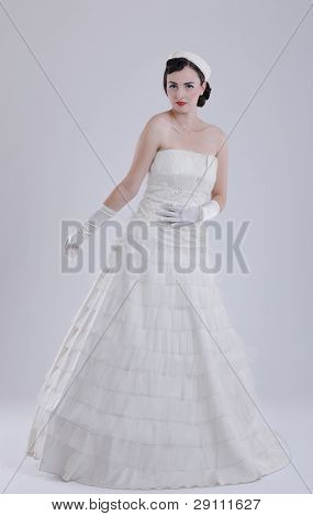 beautiful young bride wearing  wedding dress in retro fashion style isolated on white background in studio