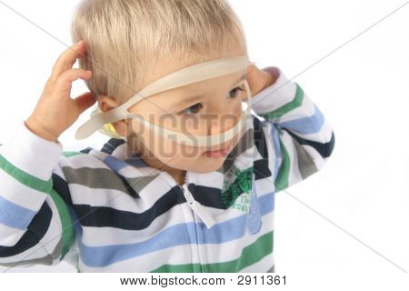 Child With Swimming Glasses