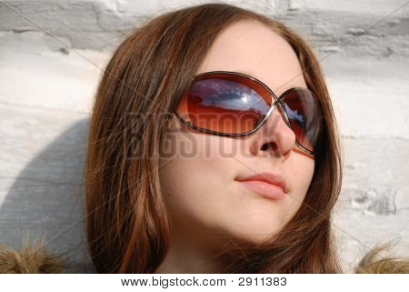 Maidenly Face In Sunglasses, Close-Up
