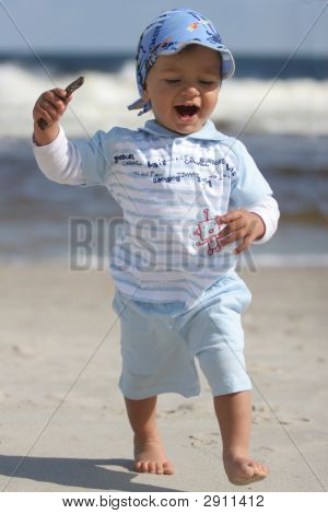 Young Boy On The Beach