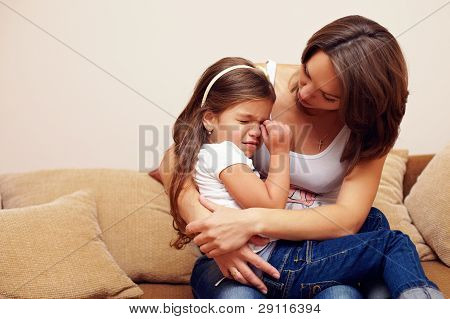 Prety Mother Soothing And Hugging Crying Baby Girl