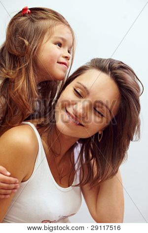 Close-up Portreit Of Happy Smiling Daughter Hugging Beautiful Mother