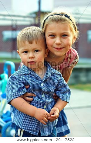 Beautiful Girl,older Sister Gently Hugging Her Little Brother Baby Boy. Outside