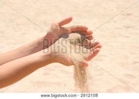 Sand Running Through Hands