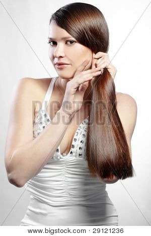 Portrait of young beautiful woman with perfect hair