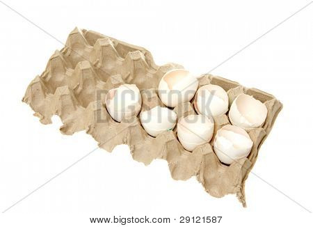 Egg shell in paper packaging isolated on the white