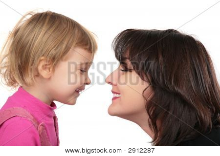 Mother And Daughter Face-To-Face
