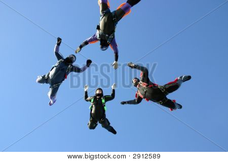 Four Skydivers Building A Star Formation While In Freefall