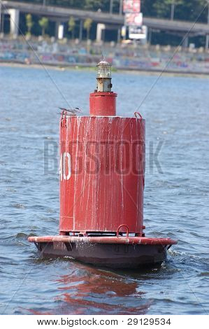 Dnepr river. A buoy marker in a river aids navigation of boats. Kiev, Ukraine