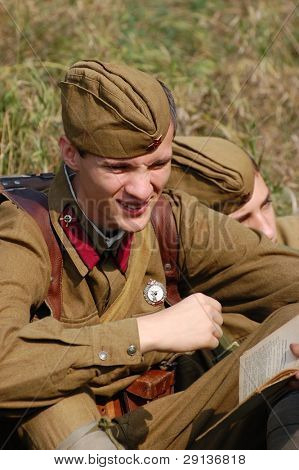 KIEV, UKRAINE - SEPTEMBER 6, 2008: Member of military history club Red Star. Person in Soviet WW2 military uniform. Historical military reenacting in Kiev, Ukraine,  September 6, 2008.