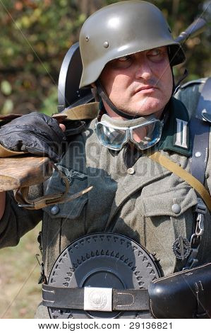KIEV, UKRAINE - SEPTEMBER 6, 2008: Member of military history club Red Star. Person in German WW2 military uniform. Historical military reenacting in Kiev, Ukraine, September 6, 2008.