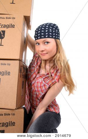 Portrait Of A Young Woman With Cardboard Boxes