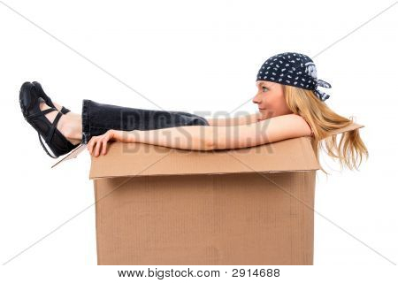 Girl Sitting In A Cardboard Box