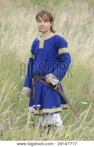 KIEV, UKRAINE - JULY 31: Member of history club Golden Capricorn wears medieval costume as he participates in historical festival and camp in memory of King Vladimir July 31, 2009 in Kiev, Ukraine.