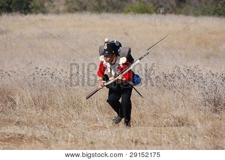 CRIMEA, UKRAINE - SEPTEMBER 26 : Member of military history club wears British historical uniform during historical reenactment of Crimean War near Alma river September 26, 2009 in Crimea, Ukraine