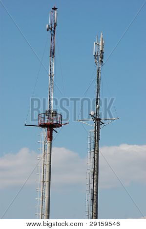 tower with various frequency antennas and transmitters