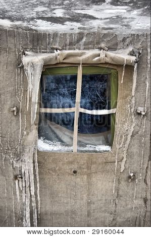 Frozen window.Soviet military tent in snow.Historical reenacting of WW2. Kiev,Ukraine