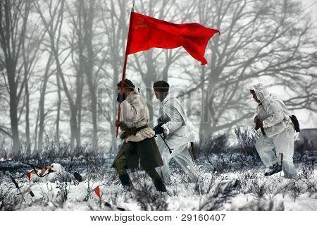KIEV, UKRAINE - FEB 14: Members of a history club wear historical Soviet uniforms in action during a WWII reenactment of 'Defense Kiev in 1943' on February 14, 2010 in Kiev, Ukraine.