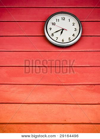 Round Clock On Red Wall