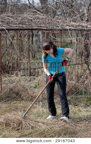 Teen girl work with rakes.Ukraine