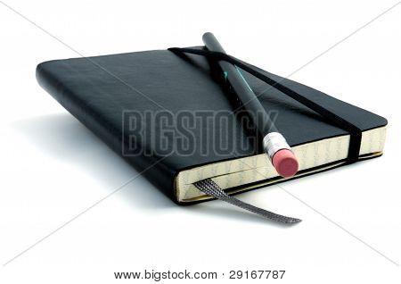 Pencil On Top Of Notebook