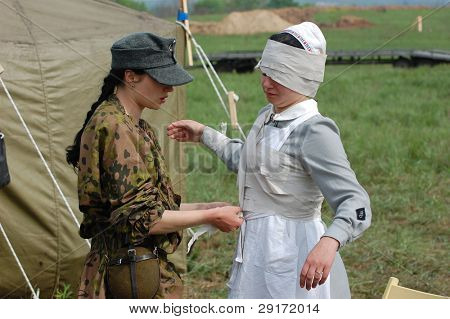 KIEV, UKRAINE - MAY 10 : members of Red Star history club wear historical military German paramedic uniform during historical reenactment of 1945 WWII, May 10, 2010 in Kiev, Ukraine.