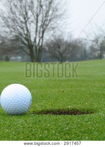 Ball Beside Hole On Green