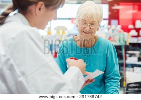 Senior woman in pharmacy talking