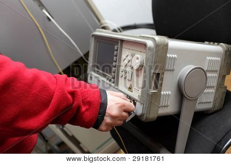 Network Engineer Touching Reflectometer